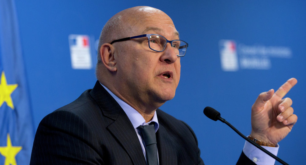 French Finance Minister Michel Sapin speaks during a media conference at the EU Council building in Brussels
